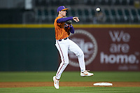 Clemson Tigers shortstop Logan Davidson (8) makes a throw to first base during the game against the Charlotte 49ers at BB&T BallPark on March 26, 2019 in Charlotte, North Carolina. The Tigers defeated the 49ers 8-5. (Brian Westerholt/Four Seam Images)
