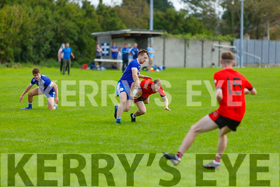 Tarberts Andrew Doherty tackled by Annascauls James Scanlon in the Junior Club Football Championship semi final.
