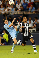 Matt Besler Sporting KC (pale blue)  clears the ball ,Leon Best Newcastle United ... Sporting Kansas City and Newcastle United played to a 0-0 tie in an international friendly at LIVESTRONG Sporting Park, Kansas City, Kansas.