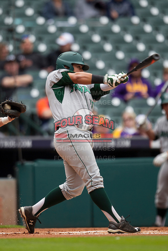 Hawaii Rainbow Warriors first baseman Eric Ramirez (13) swings the bat during the NCAA baseball game against the Nebraska Cornhuskers on March 7, 2015 at the Houston College Classic held at Minute Maid Park in Houston, Texas. Nebraska defeated Hawaii 4-3. (Andrew Woolley/Four Seam Images)