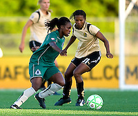 St Louis Athletica forward Enoila Aluko (9) handles the ball as FC Gold Pride midfielder Formiga (31) defends during a WPS match at Korte Stadium, in St. Louis, MO, May 9 2009.  St. Louis Athletica won the match 1-0.