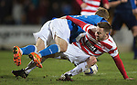 St Johnstone v Hamilton Accies...04.01.15   SPFL<br /> Jonathon Routledge tackles David Wotherspoon<br /> Picture by Graeme Hart.<br /> Copyright Perthshire Picture Agency<br /> Tel: 01738 623350  Mobile: 07990 594431