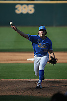 Kyle Mora (35) of the UCLA Bruins pitches against the Arizona Wildcats at Jackie Robinson Stadium on March 20, 2021 in Los Angeles, California. Arizona defeated UCLA, 7-3. (Larry Goren/Four Seam Images)