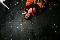 17 year old wrestler Alicia Flores (fighting name), Patricia Kaly (real name) hits the ground during a fight at the Multifuncional building in El Alto. Patricia is a Cholita, a wrestler of native Aymara descent. When Cholitas fight they wear traditional costume. The blood on Patricia's face is believed to be fake, but the wrestlers insist that it is real. ...