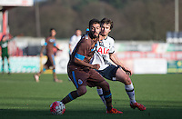 Sergio Ribeiro of FC Porto B holds off Filip Lesniak of Spurs during the Premier League U21 International Cup match between Tottenham Hotspur U21 and FC Porto B at the Lamex Stadium, Stevenage, England on 23 December 2015. Photo by Andy Rowland / PRiME Media Images