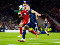 4th September 2021; Hampden Park, Glasgow, Scotland: FIFA World Cup 2022 qualification football, Scotland versus Moldova: Andy Robertson of Scotland and Ion Jardan of Moldova compete for possession of the long ball