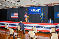 NH Republican Party chair Stephen Stepanek sits in a chair near the stage before the audience enters the venue before Eric Trump, son of US president Donald Trump, holds a Make America Great Again! campaign rally at the DoubleTree by Hilton Manchester Downtown in Manchester, New Hampshire, on Mon., Oct. 19, 2020. The chairs are distanced to follow safety protocols during the ongoing Coronavirus (COVID-19) global pandemic, just a few weeks after Donald Trump himself contracted the disease, though many other Trump campaign events are lax about COVID safety protocols.