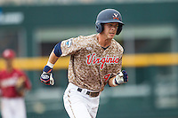 Virginia Cavaliers second baseman Ernie Clement (4) runs to third base against the Arkansas Razorbacks in Game 1 of the NCAA College World Series on June 13, 2015 at TD Ameritrade Park in Omaha, Nebraska. Virginia defeated Arkansas 5-3. (Andrew Woolley/Four Seam Images)