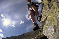 Man hiking and rock climbing in the Rocky Mountains. Jay Morris MR 614. Rocky Mountains.