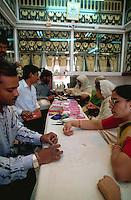 A pearl shop with salesmen and customers. Hyderabad, India.