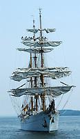 Tall Ship Furling sails in Halifax Harbor