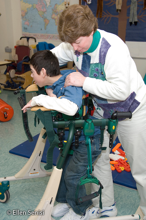 MR / Albany, NY.Langan School at Center for Disability Services .Ungraded private school which serves individuals with multiple disabilities.Physical therapist positions child in gait trainer. Boy: 11, cerebral palsy, expressive and receptive language delays.MR: Bbro12; Pie3.© Ellen B. Senisi