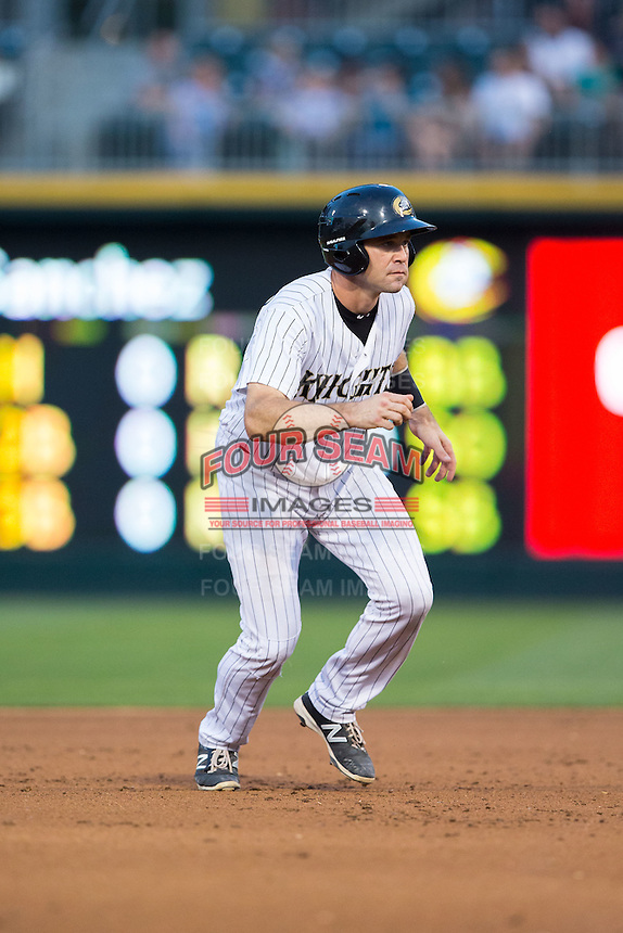 Vinny Rottino (4) of the Charlotte Knights takes his lead off of second base against the Syracuse Chiefs at BB&T BallPark on June 1, 2016 in Charlotte, North Carolina.  The Knights defeated the Chiefs 5-3.  (Brian Westerholt/Four Seam Images)