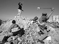 Palestinian children throw stones at Israeli soldiers in Ramallah. Palestine.