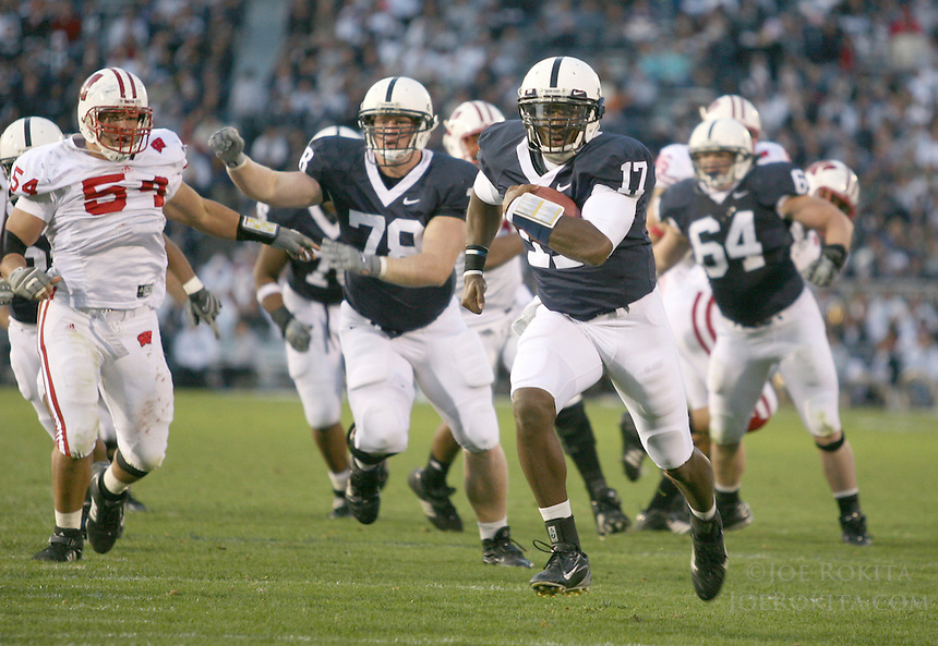 State College, PA -- 10/13/2007 -- Quarterback Daryll Clark (17) carries the ball during the fourth quarter, after the block of John Shaw (78) and Rich Ohrnberger (64).  Clark would score a one-yard touchdown on the next play.  Penn State defeated Wisconsin by a score of 38-7 on Saturday, October 13, 2007, at Beaver Stadium.    ..Photo:  Joe Rokita / JoeRokita.com