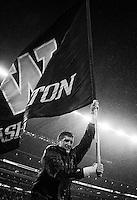 A Washington cheerleader runs the flag through the end zone following a touchdown.