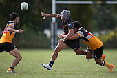 Leroy Nahi gets the ball away as Benjamin Ormsby makes the tackle. Counties Manukau Premier Club rugby game between Te Kauwhata and Onewhero, played at Te Kauwhata on Saturday April 16th 2016. Onewhero won the game 37 - 0 after leading 13 - 0 at Halftime. Photo by Richard Spranger.