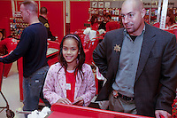 San Diego Police Officer Porter helps Nina make her purchases during the annual Shop-With-a-Cop event at the Sports Arena Target store in San Diego on December 1, 2007.  Three hundred children from all over the county rose well before dawn in order to be ready for the fleet of buses that collected them and brought them to SeaWorld where they were paired up with an officer for the event.  After breakfast they made their way to the Target store in a huge, convoy of more than three hundred police vehicles with sirens blaring, lights flashing and Santa waving from a police helicopter hovering above them.  Each child had a $100 gift card to spend and many of them resisted the temptation to buy toys and choose instead to get clothes for themselves, their siblings or parents.
