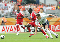 Dwight Yorke of Trinidad has John Terry of England beaten. England defeated Trinidad & Tobago 2-0 in their FIFA World Cup group B match at Franken-Stadion, Nuremberg, Germany, June 15 2006.