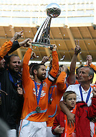Houston players with the Alan I. Rothenberg trophy held by team captain Wade Barrett. The Houston Dynamo defeated the New England Revolution 2-1 in the finals of the MLS Cup at RFK Memorial Stadium in Washington, D. C., on November 18, 2007.