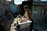 Nadia Yusuf is a Turkish-speaking Roma woman, here washing her dishes in the Maxsuda neighborhood of Varna, Bulgaria.