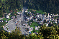 Switzerland. Canton Graubunden. Bregaglia valley. View from Soglio on Bondo. The village was hit by two massive landslides caused by a giant rockslide swept down from Piz Cengalo on August 23, 2017. The mudslide smash in Bondo a bridge, the carpentry factory, barns and equipment that was being used to clear debris from the first landslide. 26.08.2017 © 2017 Didier Ruef