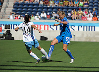 Boston midfielder Leslie Osborne (12) wins the ball from Chicago midfielder Karen Carney (14).  The Boston Breakers defeated the Chicago Red Stars 3-1 at Toyota Park in Bridgeview, IL on July 25, 2010