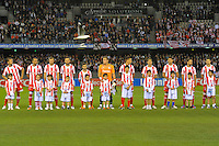 MELBOURNE, AUSTRALIA - MAY 19:  Olympiakos players listen to the Greek national anthem at a match between Melbourne Victory and Olympiakos FC at Etihad Stadium on 19 May 2012 in Melbourne, Australia. (Photo Sydney Low / AsteriskImages.com)