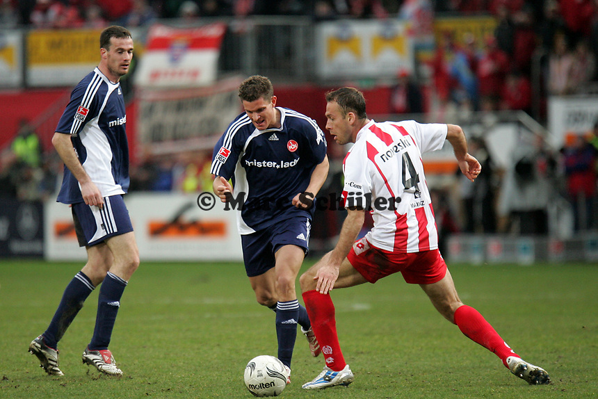Gerald Sibon (1. FC N¸rnberg) im Zweikampf mit Nikolce Noveski (FSV Mainz 05)