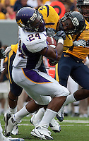 A WVU defender puts a hard hit on East Carolina running back Dominque Lindsay. The WVU Mountaineers defeated the East Carolina Pirates 35-20 at Mountaineer Field at Milan Puskar Stadium, Morgantown, West Virginia on September 12, 2009.