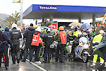 Riders wait for the race to restart in Cogoleto after heavy snow forces the race organizers to abandon part of the race over Passo del Turchino during the 104th edition of the Milan-San Remo cycle race, 17th March 2013 (Photo by Eoin Clarke 2013)