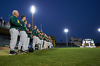 Siena Saints head coach Tony Rossi (40) stands with his team during the national anthem before a game against the Stetson Hatters on February 23, 2016 at Melching Field at Conrad Park in DeLand, Florida.  Stetson defeated Siena 5-3.  (Mike Janes/Four Seam Images)