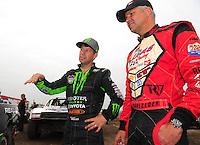 Mar. 20, 2011; Chandler, AZ, USA;  LOORRS pro four driver Carl Renezeder (right) with Johnny Greaves during round two at Firebird International Raceway. Mandatory Credit: Mark J. Rebilas-