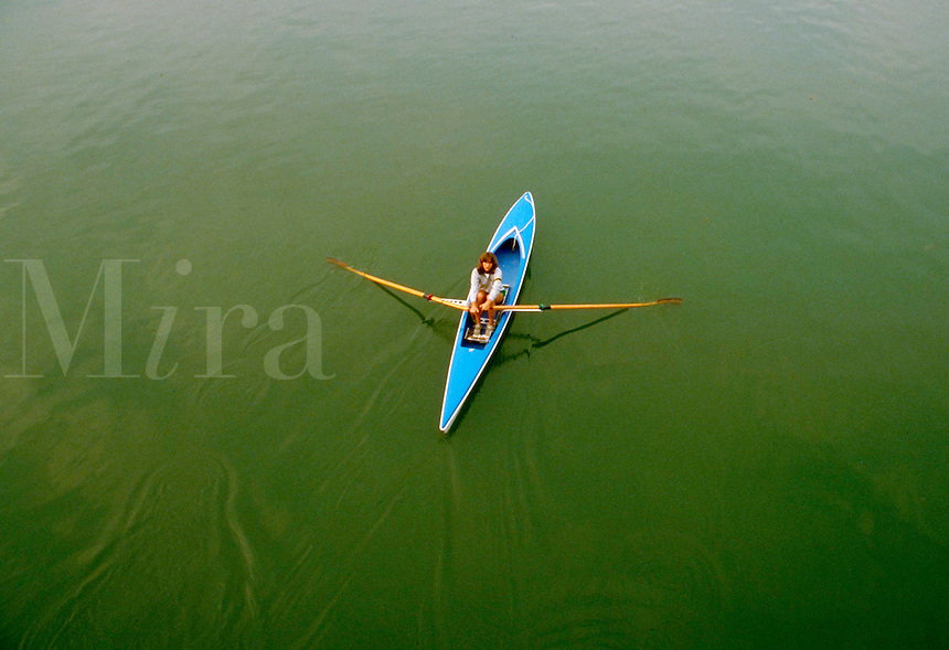 Woman in Scull, rowing. Buffalo New York, Eire Canal.