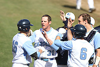 Seth Baldwin, #16, is greeted by Jimmy Messer, #31, of the North Carolina Tar Heels after hitting a home run against the Missouri Tigers at Dedeaux Field on February 20, 2011 in Los Angeles,California. Photo by Larry Goren/Four Seam Images