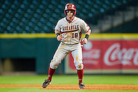 Tim Carver #18 of the Arkansas Razorbacks takes his lead off of first base against the Houston Cougars at Minute Maid Park on March 3, 2012 in Houston, Texas.  The Cougars defeated the Razorbacks 4-1.  (Brian Westerholt/Four Seam Images)