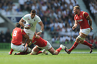 Luther Burrell of England is tackled by Taulupe Faletau of Wales during the Old Mutual Wealth Cup match between England and Wales at Twickenham Stadium on Sunday 29th May 2016 (Photo: Rob Munro/Stewart Communications)