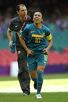 MARTA of Brazil grimaces as she leaves the field with an injury - New Zealand Women vs Brazil Women - Womens Olympic Football Tournament London 2012 Group E at the Millenium Stadium, Cardiff, Wales - 28/07/12 - MANDATORY CREDIT: Gavin Ellis/SHEKICKS/TGSPHOTO - Self billing applies where appropriate - 0845 094 6026 - contact@tgsphoto.co.uk - NO UNPAID USE.