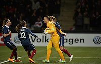 Lorient, France. - Sunday, February 8, 2015: Goalkeeper Sarah Bouhaddi (16) of France celebrates saving a penalty kick. France defeated the USWNT 2-0 during an international friendly at the Stade du Moustoir.