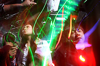 China. Jilin Province. Young people dancing in a nightclub in the town of Yanji, close to the border with North Korea. The town is part of the Korean Autonomous Prefecture in the north-east of the country. 2011