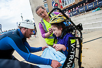 COPY BY TOM BEDFORD<br /> Sunday 26 June 2016<br /> Pictured: Poppy helped by the team in the transition area <br /> Re: A very special father-and-daughter team have tackled the Cardiff Triathlon.<br /> Poppy Jones, 11, who will be competing alongside dad Rob Jones, wants to win the event.<br /> And she's not going to let the fact that she has quadriplegic cerebral palsy , which means she can't sit, stand, roll or support herself, and chronic lung disease stop her.<br /> She will be by Rob's side every step of the way thanks to a cutting-edge wheelchair and boat – for Rob to push or pull – designed especially for the event, which sees participants take part in a swim across Cardiff Bay , a run and a bike ride.