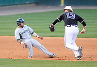 Catcher John Martinez (3) of the Michigan State Spartans is caught in a rundown by Harrison Farmer (13) of the Furman Paladins in a game on February 25, 2012, at Fluor Field in Greenville, South Carolina. (Tom Priddy/Four Seam Images)