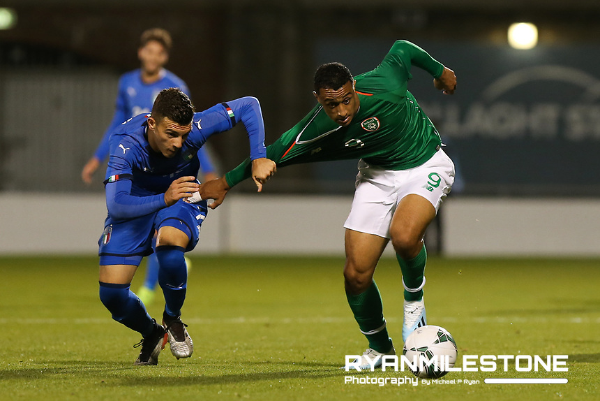 EVENT:<br /> UEFA European U21 Championship Qualifier Group 1 Republic of Ireland v Italy<br /> Thursday 10th October 2019,<br /> Tallaght Stadium, Dublin<br /> <br /> CAPTION:<br /> Adam Idah of Republic of Ireland in action against Alessandro Bastoni of of Italy.<br /> <br /> Photo By: Michael P Ryan
