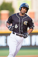 Marcus Semien (6) of the Charlotte Knights rounds the bases after hitting a home run against the Scranton/Wilkes-Barre RailRiders at BB&T Ballpark on July 17, 2014 in Charlotte, North Carolina.  The Knights defeated the RailRiders 9-5.  (Brian Westerholt/Four Seam Images)