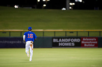 AZL Cubs center fielder Chris Singleton (16) jogs to center field between innings of a game against the AZL Giants on July 17, 2017 at Sloan Park in Mesa, Arizona. AZL Giants defeated the AZL Cubs 12-7. (Zachary Lucy/Four Seam Images)