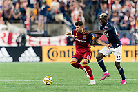 FOXBOROUGH, MA - SEPTEMBER 21: Damir Kreilach #8 of Real Salt Lake dribbles as Wilfried Zahibo #23 of New England Revolution defends during a game between Real Salt Lake and New England Revolution at Gillette Stadium on September 21, 2019 in Foxborough, Massachusetts.