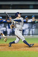 Thomas Milone (21) of the Princeton Rays follows through on his swing against the Burlington Royals at Burlington Athletic Park on July 9, 2014 in Burlington, North Carolina.  The Rays defeated the Royals 3-0.  (Brian Westerholt/Four Seam Images)