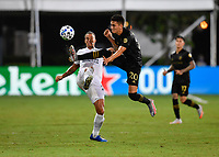 LAKE BUENA VISTA, FL - JULY 18: Rolf Feltscher #25 of LA Galaxy has the ball played away by Eduard Atuesta #20 of LAFC during a game between Los Angeles Galaxy and Los Angeles FC at ESPN Wide World of Sports on July 18, 2020 in Lake Buena Vista, Florida.
