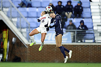 CHAPEL HILL, NC - NOVEMBER 16: Julie Garst #15 of Belmont University and Maycee Bell #25 of the University of North Carolina challenge for a header during a game between Belmont and North Carolina at UNC Soccer and Lacrosse Stadium on November 16, 2019 in Chapel Hill, North Carolina.