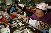 Workers at Taifu (Fuzhou) Co. Ltd, hand-made accessories in Fuzhou City, China. The Taiwanese-owned factory makes jewellery and hand-painted toys and figures for overseas companies..02-MAR-04